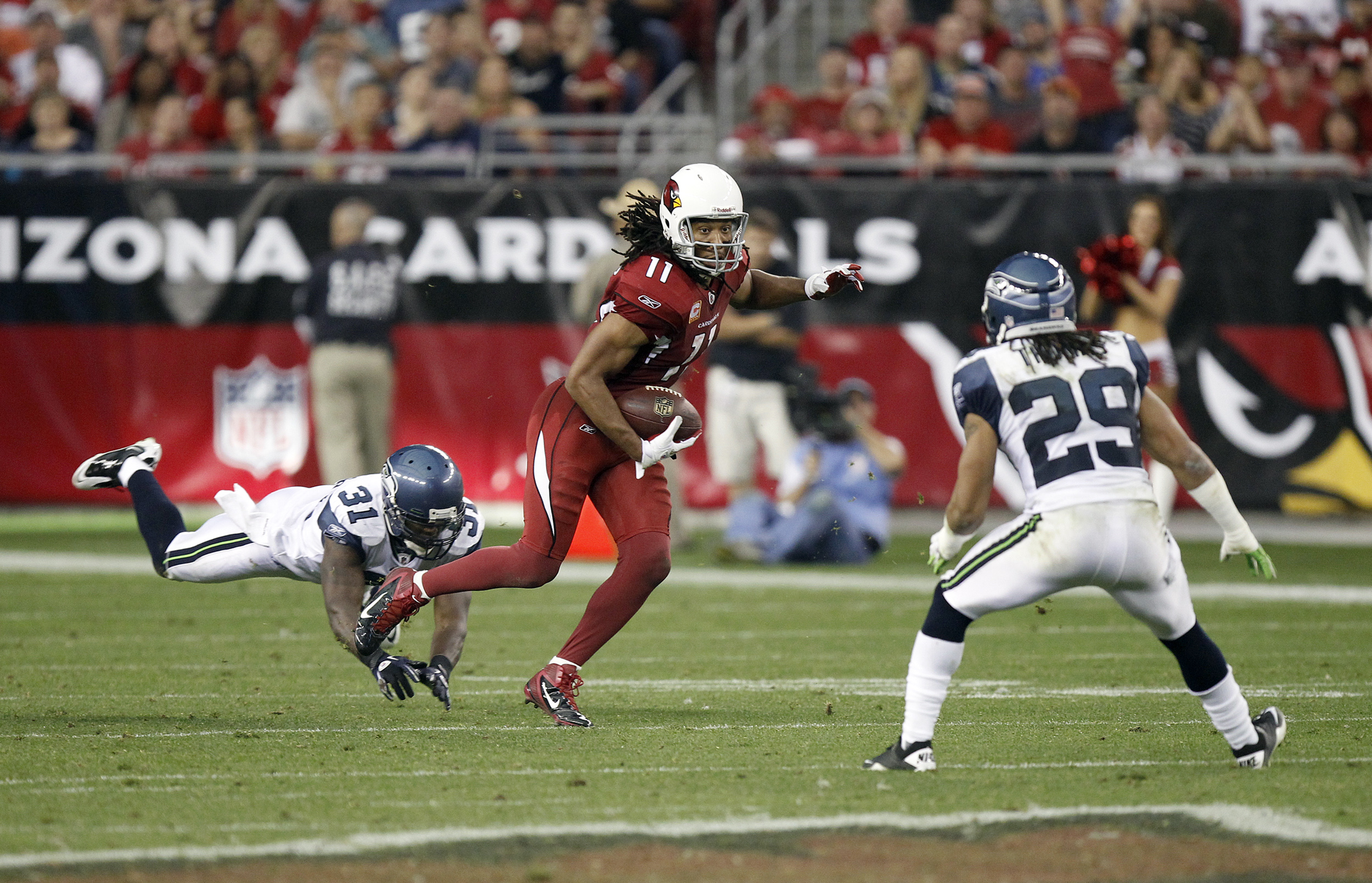 Larry Fitzgerald, Kam Chancellor, Earl Thomas. Cardinals - Seahawks